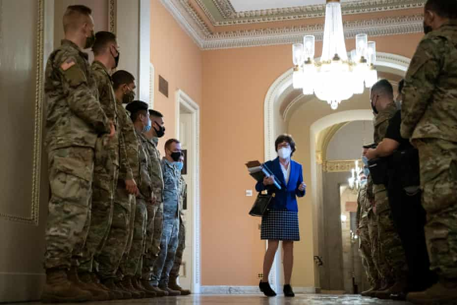 Senator Susan Collins talks to national guard troops on the third day of Donald Trump's second impeachment trial.