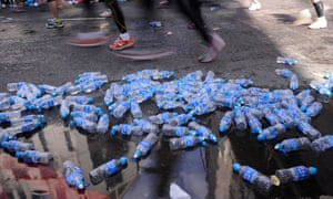 Masses of discarded water bottles during the London Marathon.