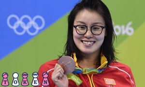 Chin's Fu Yuanhui poses with her bronze medal on the podium of the Women's 100m Backstroke during the swimming event at the Rio 2016 Olympic Games at the Olympic Aquatics Stadium in Rio de Janeiro on August 8, 2016. / AFP PHOTO / GABRIEL BOUYSGABRIEL BOUYS/AFP/Getty Images