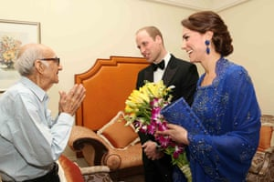 The Duke and Duchess of Cambridge speak with Boman Kohinoor during a meeting in Mumbai on Monday. Kohinoor, 93, has a strong claim to be India's biggest fan of the British royal family – giant cardboard cutouts of William and Kate adorn his restaurant. His dream of meeting the royals came true after William and Kate were made aware of a social media campaign with the hashtag #WillKatMeetMe