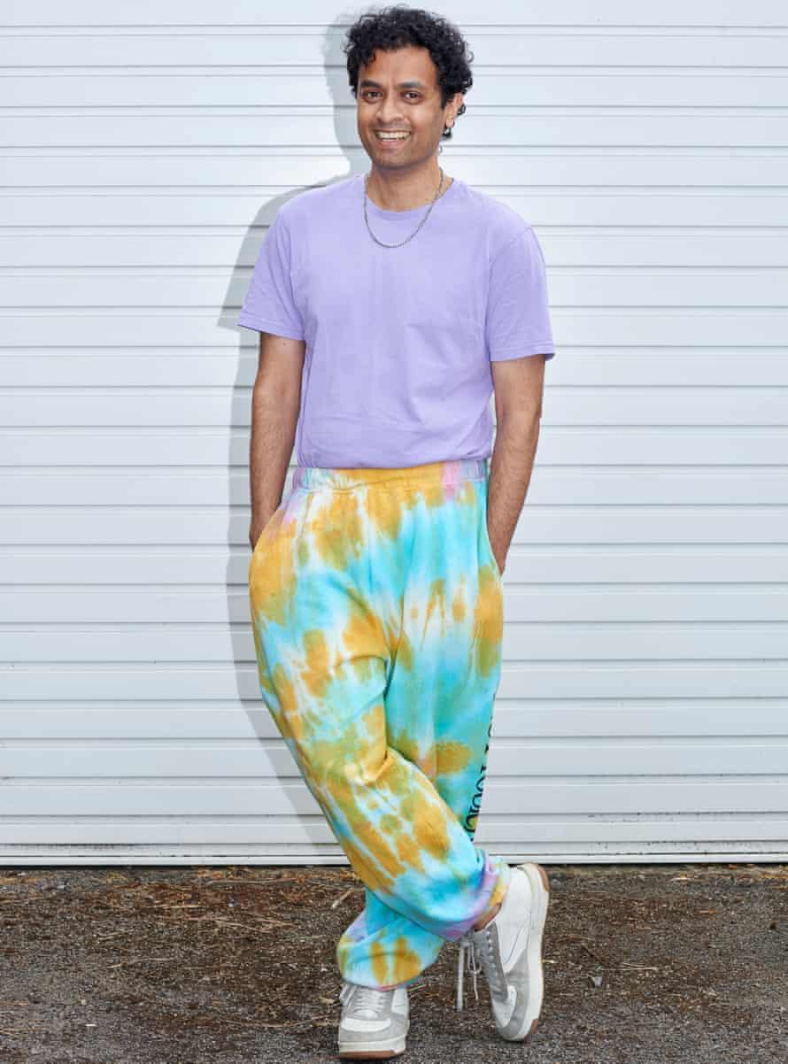 Priya Elan in tie-dye baggy trousers, purple T-shirt and silver chain