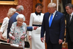 Queen Elizabeth II views a display of US items of the Royal collection with US President Donald Trump and US First Lady Melania Trump at Buckingham palace