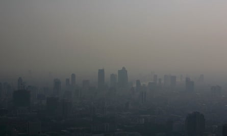 Bangkok's skyline is seen blanketed in a haze during late afternoon of February 1, 2007. The Intergovernmental Panel on Climate Change (IPCC) will release a long-awaited report assessing the human link to pollution, global warming and climate change in Paris on February 2, 2007. A draft of the report, which draws on research by 2,500 scientists from more than 130 countries, projects a big rise in temperatures this century and warns of more heatwaves, floods, droughts and rising sea levels linked to greenhouses gases released mainly by the use of fossil fuels. REUTERS/Adrees Latif (THAILAND)