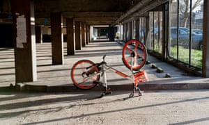 An abandoned Mobike at the Aylesbury estate, London. Operators experience high losses of dockless cycles to vandalism and theft.