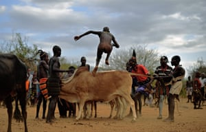 A man from the Hamar tribe takes part in a bull jumping ceremony