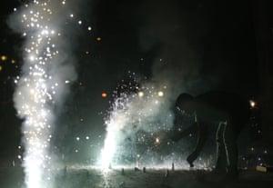 An Indian man lights firecrackers during Mumbai's new year celebration