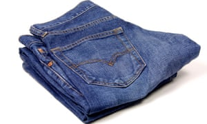 A folded up pair of blue jeans
