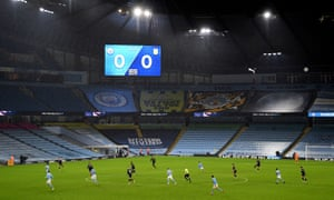 General view of the action on the pitch as the second half kicks off in front of empty stands.
