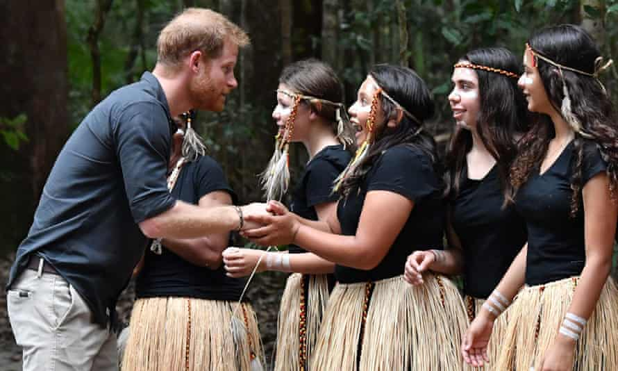 Prince Harry talks to members of the Butchulla people, who are the traditional owners of Fraser Island.