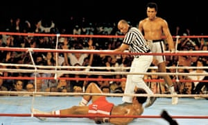 Referee Zack Clayton calls the count over Ali's opponent George Foreman, at the 'Rumble in the Jungle'.
