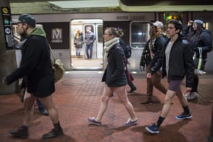 Participants in the No Pants Subway Ride DC, walk through the a Metro station on January 7, 2018 in Washington, DC.
