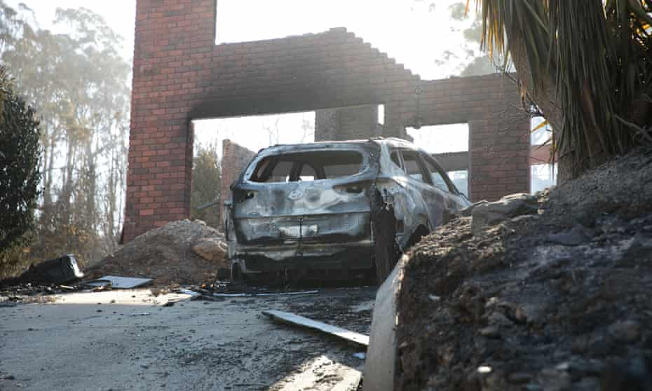 burnt out car in driveway at Tathra