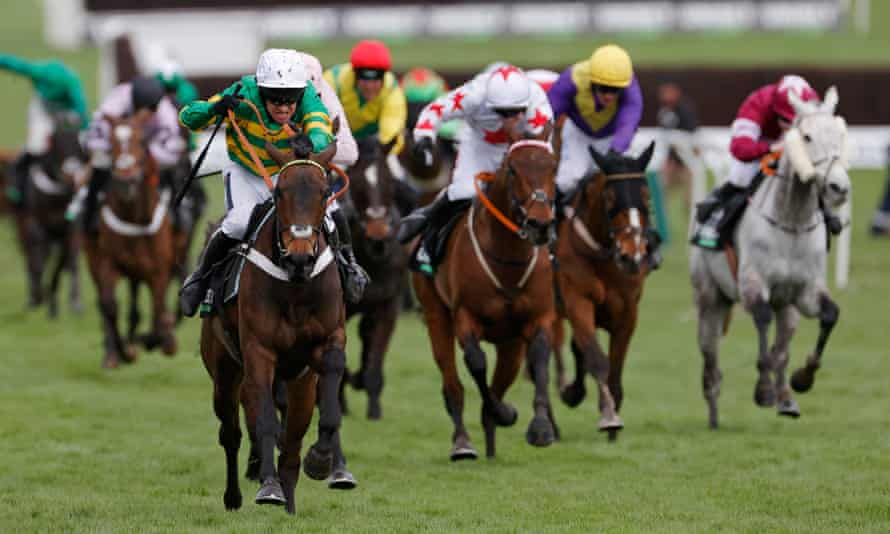 Epatante (left) sprints clear of the field to win the Champion Hurdle.