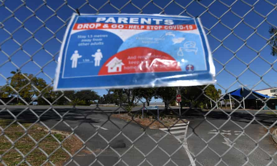 A sign advises of Covid hygiene practices on a locked gate at the entrance to a school in Logan, south of Brisbane, last year.