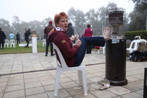 The One Nation leader, Pauline Hanson, holds her feet to a fire