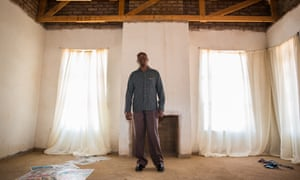 Elmon Zondo, an ex-owner driver, gazes at the unfinished ceiling in his house in Soshanguve, Pretoria.