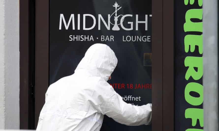 A police investigator enters the Midnight shisha bar in Hanau where the gunman began his shooting spree.