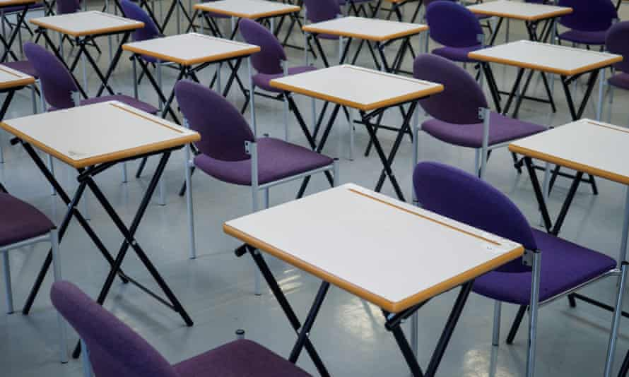 Empty desks are seen in a school hall