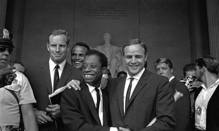 Actor Marlon Brando, right, poses with his arm around James Baldwin in front of the Lincoln statue at the Lincoln Memorial, August 28, 1963.
