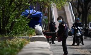 woman in mask in Beijing street