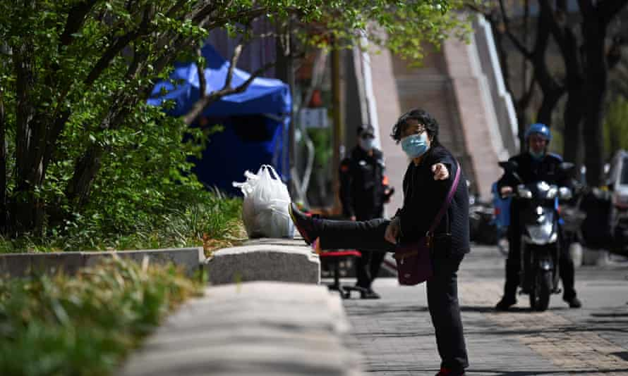 woman in mask in Beijing street