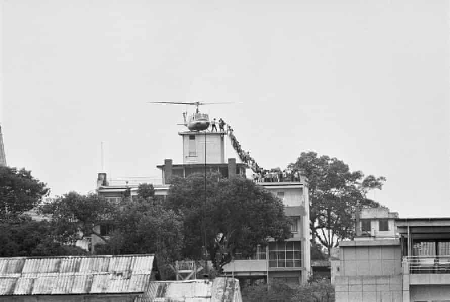 Evacuees mounting a staircase to board an American helicopter on the top of an apartment building near the US embassy in Saigon in 1975.