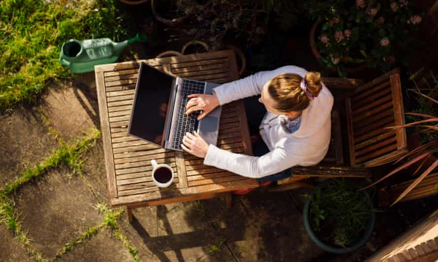 Elevated view of a woman working from home in her garden