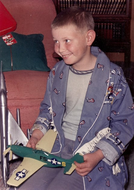 The eight-year-old Sullenberger receiving a model aeroplane on Christmas morning. He knew he wanted to be a pilot from a very young age.