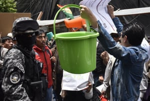 People demand Bolivian President Evo Morales to remove Environment and Water Minister Alexandra Moreira and find a solution to the water shortage that is affecting Bolivia, during a protest in front of the Economy Ministry in La Paz
