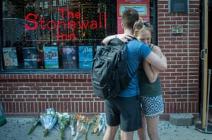New York, US. A pair embrace at a vigil for the mass-shooting victims outside the Stonewall Inn