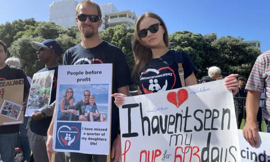 Daniel Bredenkamp and Polina Chernysova protest at Parliament House in Wellington, New Zealand about Covid restrictions on family travel.