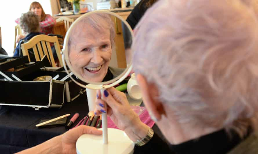 A resident of Albert Edward Prince of Wales Court care home enjoys a makeup session by Beautiful You.