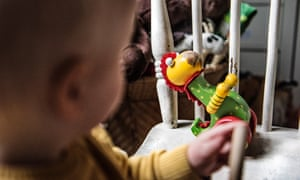 A child plays with a wooden toy