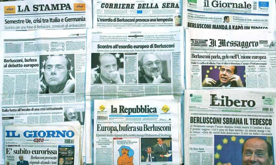 Italian newspapers, with La Stampa, top left and La Repubblica, below centre.