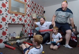 England football fans brothers Malc and Rick Cooper with Rick's sons Leo and Aaron in Milnrow, Rochdale, 24 June 2018