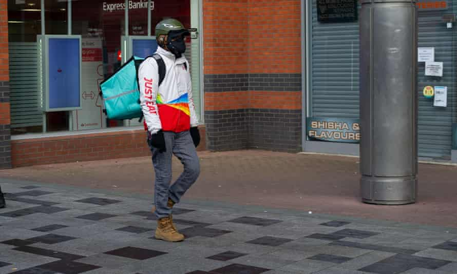 A Just Eat delivery person