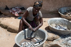 In Nyanyano, a local fishmonger covered in scales prepares fish caught earlier that morning. Protein is rare in Ghana and usually reserved for consumption by male household heads