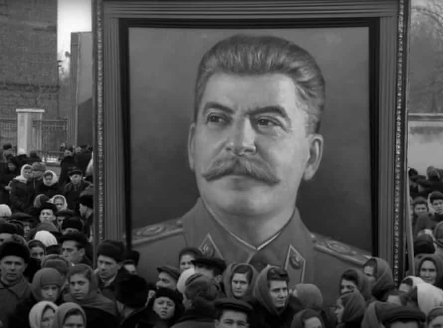 Mourners carry portrait of Stalin