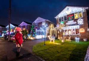 A child enjoys the annual festive light display put on by neighbours in Stone Brig Lane, Rothwell
