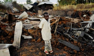 A child stands amid the ruins of a church that was burned to the ground killing 18 people during violence after Kenya's 2007 election.