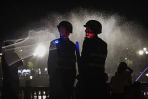 Police stand near a local government tourism development in Kashgar, China.