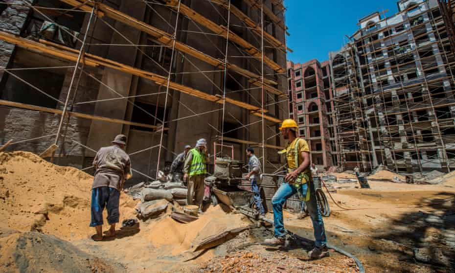 Labourers work at the construction site of the new Egyptian administrative capital, 40km east of Cairo.