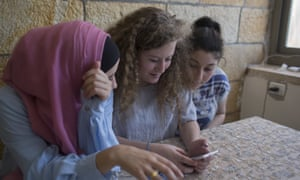 Ahed Tamimi, centre, with her friends at the family home in the West Bank village of Nabi Saleh.