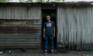Arnovis Guidos Portillo outside his house in Usulatan, which is ruled by gangs.