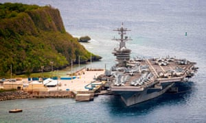 The aircraft carrier USS Theodore Roosevelt moored pier side at Naval Base Guam on 15 May 2020.