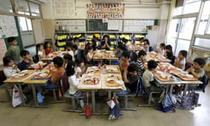First grade students and teacher Teruko Takakusaki give thanks at Takinogawa elementary school
