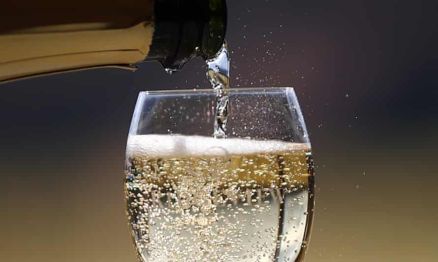 A glass of sparkling wine being poured