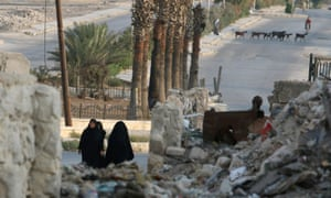 Women walk through the rubble of a neighbourhood in Aleppo, Syria, 30 August 2016.