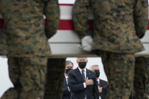 Delaware, USPresident Biden watches as the remains of Marine Lance Corporal Kareem M. Nikoui aged 20 from California who was killed in a bomb attack in Kabul, Afghanistan are unloaded during a casualty return at Dover Air Force Base.