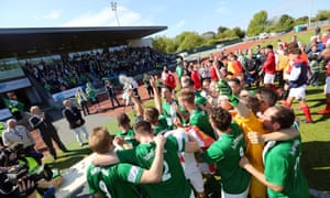 Guernsey's players celebrate with the Muratti Vase after victory over Jersey at Footes Lane